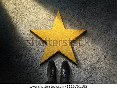 Success in Business or Personal Talent Concept. Top View of Businessman in Shiny Oxford Shoes standing in front of a Golden Star on the Dark Cement Floor Royalty-Free Stock Photo #1115751182
