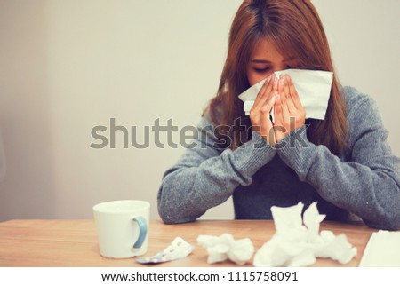close up asian woman holding tissue in hand for reaction sneezing after feeling sick for healthcare and coronavirus (cove-19) infection disease concept #1115758091