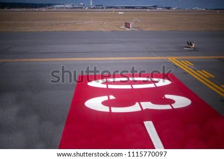 Air port runway taking off sign Perth city, Australia #1115770097