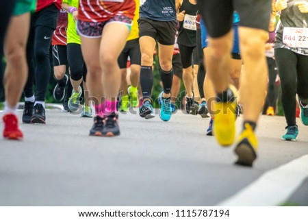 Chiang Mai, Thailand - June 17th, 2018 : Group of Chiang Mai people feet running in marathon running race on June 17th, 2018 in Chiang Mai Thailand #1115787194