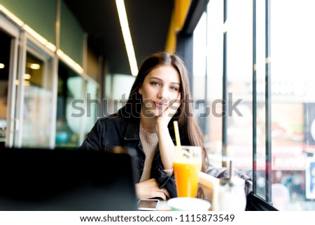 women who is in cafe #1115873549