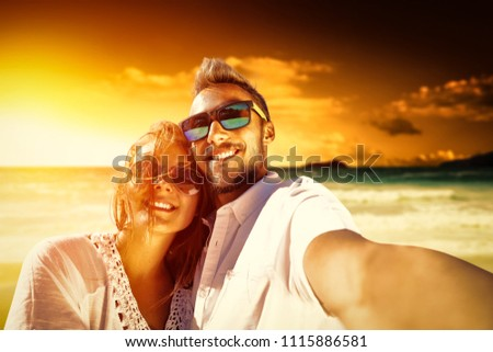 Summer time on beach and two lovers. Mood photo of sunet time.  #1115886581