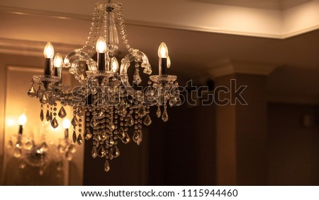 Chrystal chandelier lamp on the ceiling in Dining room Adjusting the image in a Luxury tone .Decorative elegant vintage and Contemporary interior Concept. #1115944460
