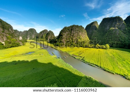 the majestic scenery on Ngo Dong river in Tam Coc Bich Dong view from the mountain top in Ninh Binh province of Viet Nam  Royalty-Free Stock Photo #1116003962
