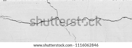 crack white wall texture  Royalty-Free Stock Photo #1116062846