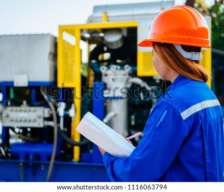 Engineer woman in industry factory checking production. #1116063794