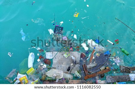 Garbage in the ocean sea  Royalty-Free Stock Photo #1116082550