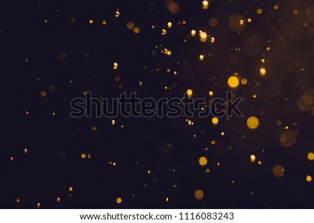 Dark Abstract Gold bokeh sparkle on black background #1116083243