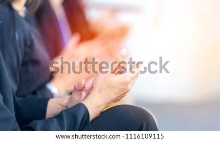 Businessman clapping hands during seminar or teamwork meeting. Congratulation to  team member who receives award after business project success. Succeed from team collaboration, diversity idea, unity #1116109115