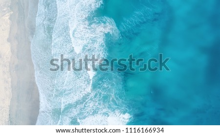Waves on the beach as a background. Beautiful natural background at the summer time #1116166934