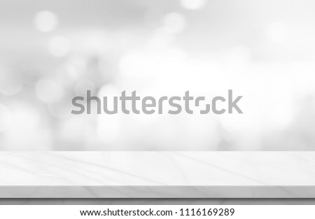 Empty white marble over blur background, for your photo montage or product display, Space for placing items on the table, product and food display. #1116169289