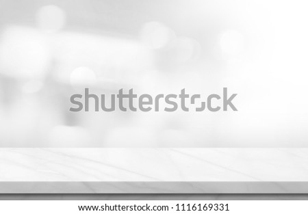Empty white marble over blur background, for your photo montage or product display, Space for placing items on the table, product and food display. #1116169331