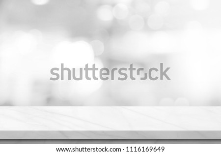 Empty white marble over blur background, for your photo montage or product display, Space for placing items on the table, product and food display. #1116169649