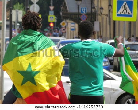 Moscow, Russia - 19 June 2018: Football fans from Senegal in Moscow during the FIFA world Cup 2018. Senegalese fans celebrate the victory of the national team over Poland #1116253730