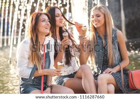 Girlfriends eating ice cream #1116287660