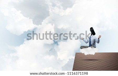 Faceless businessman with camera zoom instead of head sitting in lotus pose #1116371198