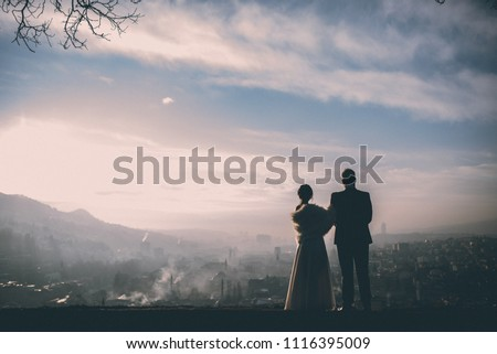 Just married couple sharing best moments of the wedding day with each other #1116395009