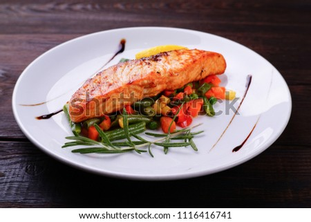 Grilled salmon steak with vegetable garnishing, tasty and delicious meals, dietary food, keto diet concept #1116416741
