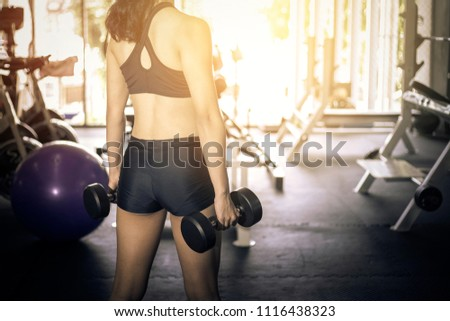 Fitness sport woman with sportwear exercise in the fitness gym. #1116438323