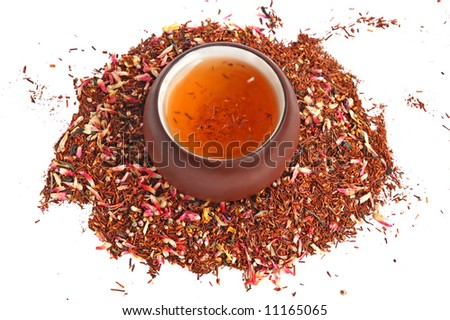 A mix of flower and roibos fruit tea tea leaves with cup of tea #11165065