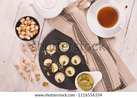Pistachio truffles on wooden table. #1116556334