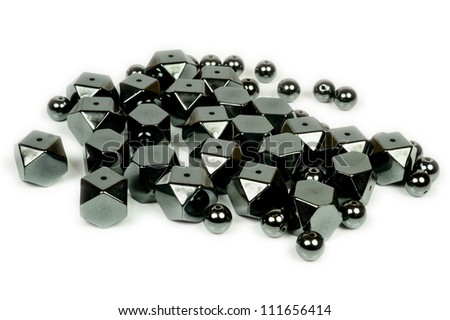Pile of shiny black Hematite beads in mixed shapes. #111656414