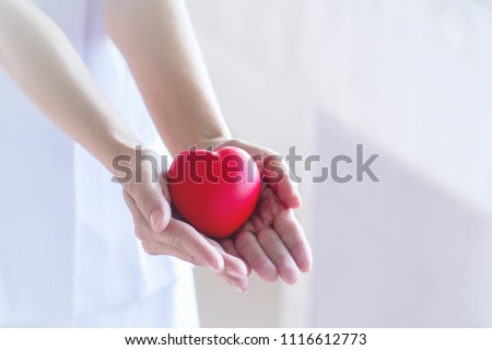 Closeup Nurse hands holding and giving red heart in hospital.healthy and healthcare concept with selective focus. #1116612773