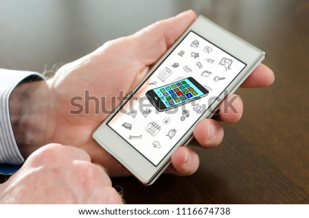 Hand holding a smartphone with apps concept #1116674738