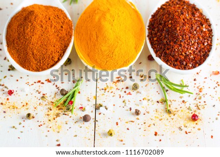 Spices in Wooden spoon. Herbs. Curry, Saffron, turmeric, rosemary, cinnamon, garlic, pepper, anise on wooden rustic background. Collection of spices and herbs. Salt, paprika. Copy space. Top view. Ban #1116702089