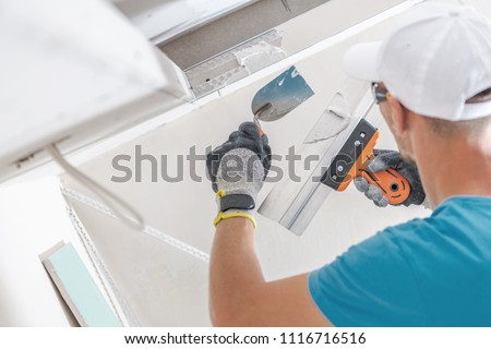 Building Drywall Ceiling Elements For LED Lighting. Caucasian Worker Patching Drywall. #1116716516