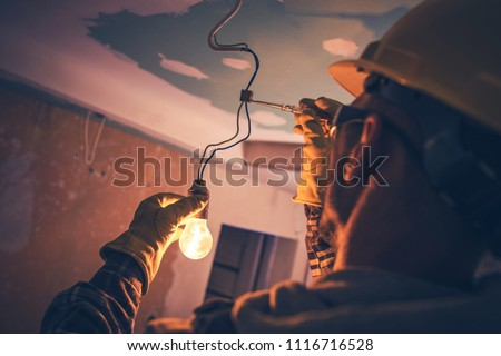 Working Contractor Electrician. Fixing the Light. #1116716528