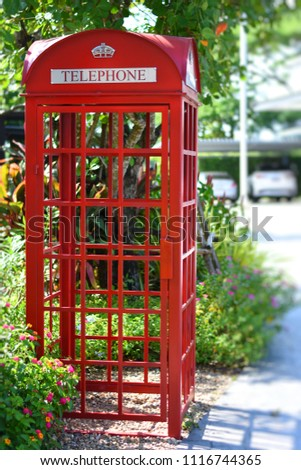 Vintage British public phone.Red telephone booth or Public payphone British style. #1116744365