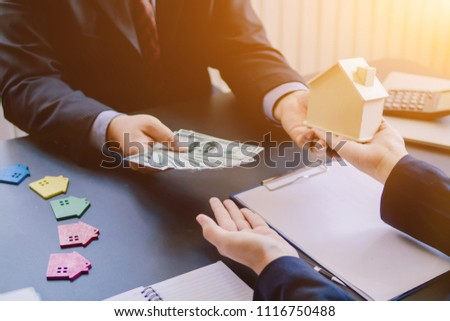 Soft Focus,Two businesspeople are discussing in the office in the morning at a window-based business desk and a male businessman has invited a businesswoman to join in a sought-after estate. #1116750488
