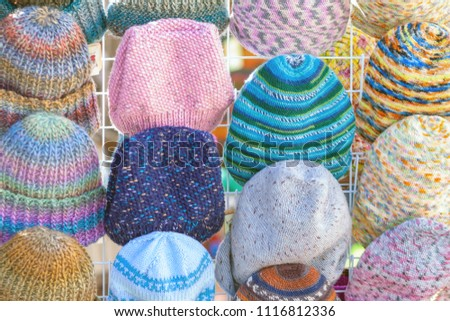 A lot of knitted hats. Market Showcase #1116812336