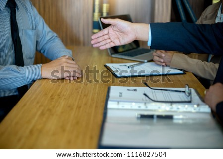 job interview for new staff in the office room two boss sit to  employee and read resume #1116827504