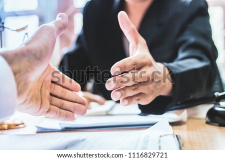 Close-up Shake hands lawyers in office. Counseling and Give an advice between private and government officials to find a fair settlement. instagram style filter  Royalty-Free Stock Photo #1116829721