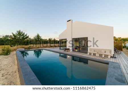 Modern house with garden swimming pool and wooden deck #1116862475