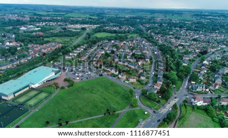 Kirkintilloch, Glasgow, Scotland, UK; June 12th 2018: Low level aerial image over the Leisure Centre at Woodhead Park in the town of Kirkintilloch in Scotland. #1116877451