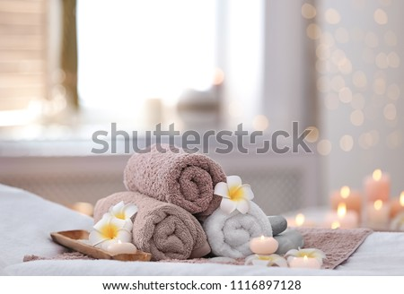 Beautiful spa composition on massage table in wellness center Royalty-Free Stock Photo #1116897128