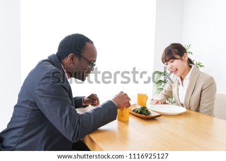 Business persons enjoying eating #1116925127