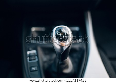 Manual gearbox handle in the car  #1117119422