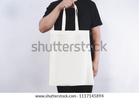 man with cotton bag  shopping bags eco mockup #1117145894
