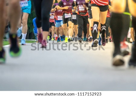 Chiang Mai, Thailand - June 17th, 2018 : Group of Chiang Mai people feet running in marathon running race on June 17th, 2018 in Chiang Mai Thailand #1117152923