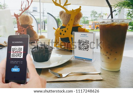 Qr code payment, E wallet , cashless technology concept. Man scanning tag in Coffee shop accepted generate digital pay without money. #1117248626