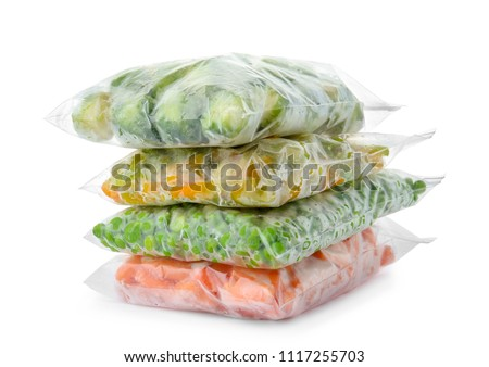 Plastic bags with frozen vegetables on white background Royalty-Free Stock Photo #1117255703