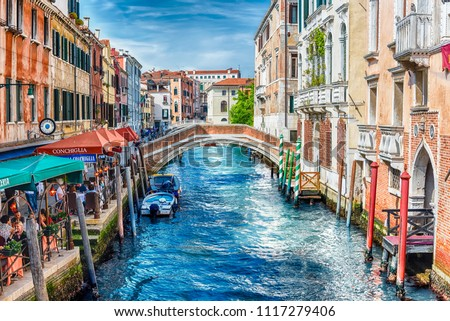 VENICE, ITALY - APRIL 29: Traditional Gondolas with scenic architecture along the canal Rio dei Greci, in Castello district of Venice, Italy, April 29, 2018 #1117279406
