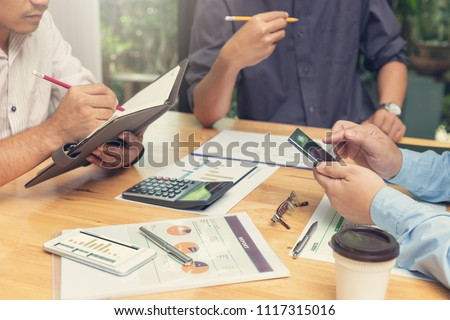 Business and finance concept of office working,Teamwork of Businessmen discussing business investment plan in office #1117315016