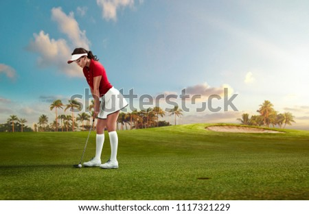 Woman golfer playing golf on the field #1117321229