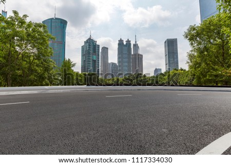 Empty Road with modern business office building #1117334030