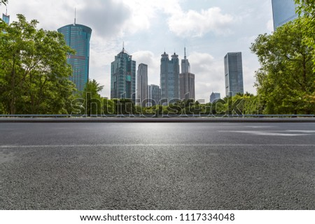 Empty Road with modern business office building #1117334048